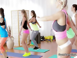Busty fitness lesbians threesome at gym